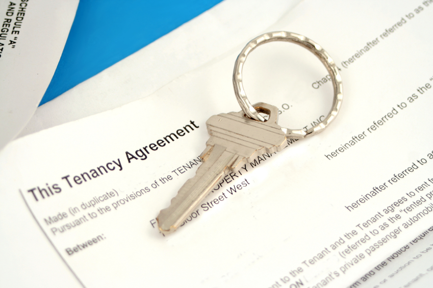 some paperwork concerning tenancy agreement with key