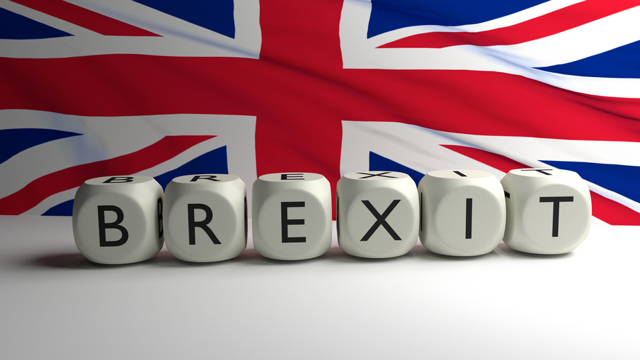 Brexit written on dices with UK flag in background, Great Britain leaving the EU, 3D render