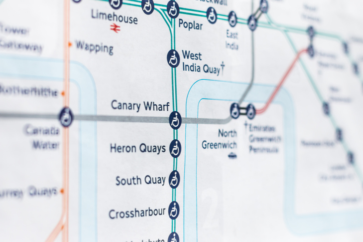 A close up shot of the Docklands Light Railway underground tube line as diagrammed on an official Transport for London map.