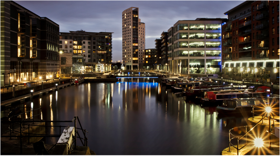 Clarence Dock in Leeds, West Yorkshire, England at Night, showing Apartments, The Royal Armouries, Restaurant, Barges and Narrow Boats.