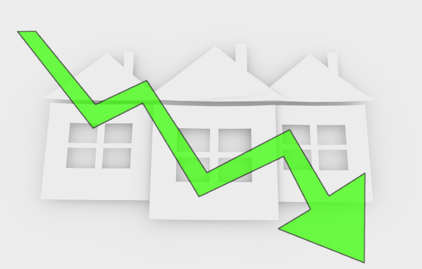 falling real estate prices - conceptual symbol with green arrow