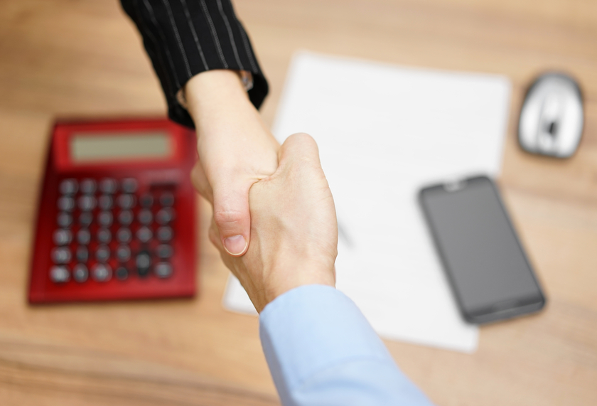 Top view of businesswoman shaking  hand  with businessman  after negotiation