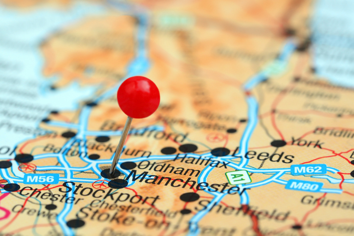 Photo of pinned Manchester on a map of europe. May be used as illustration for traveling theme.