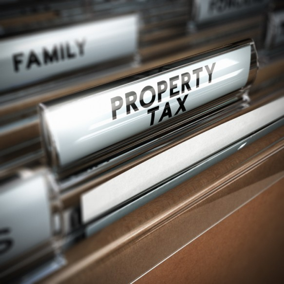 Files with the text property tax written on the tab, close up and blur effect. Realistic 3D render