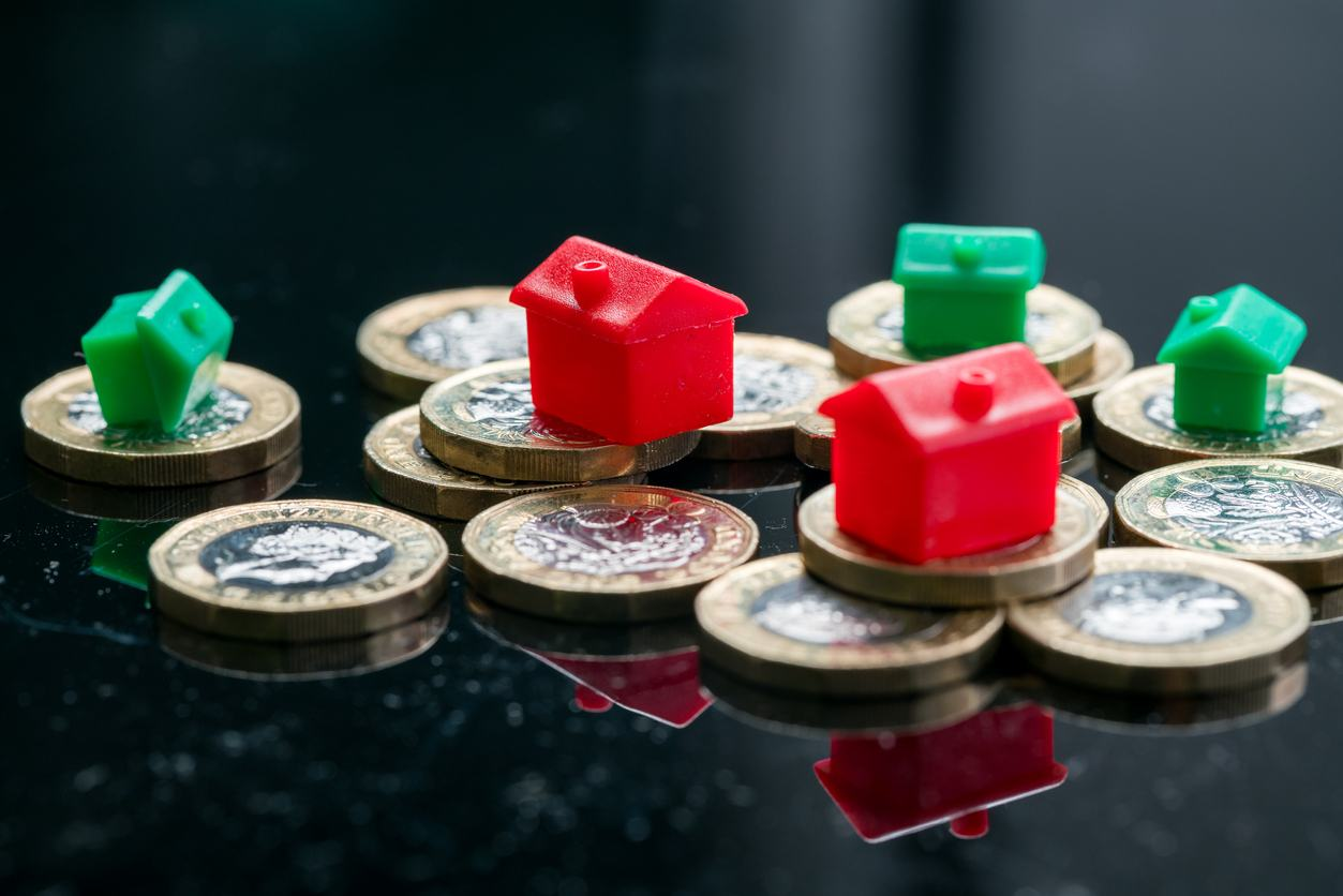 Housing estate concept with coins in studio - Landlord News