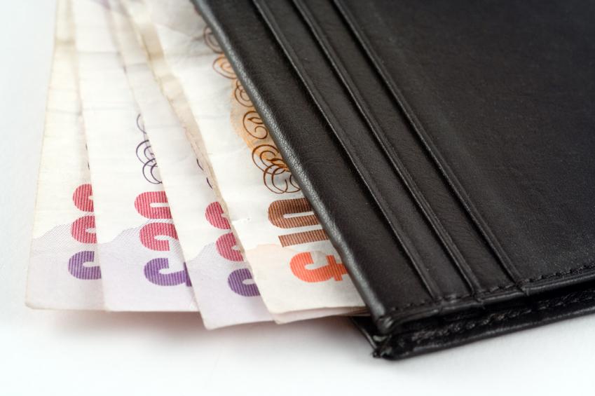 Cash in an open wallet