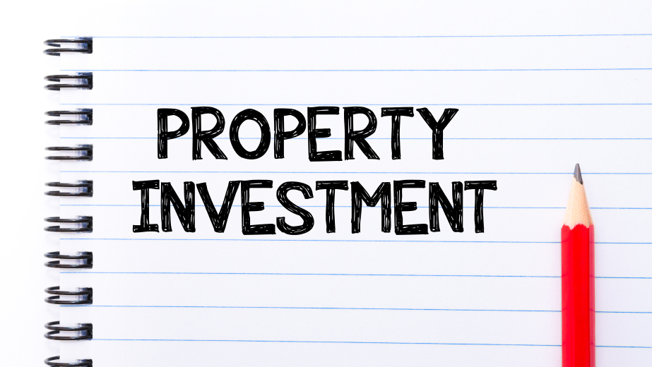 Property Investment Text written on notebook page, red pencil on the right. Motivational Concept image